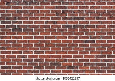 Empty brickwork background. Wallpapers of stable masonry. Rough surface. The texture of the surface is a dark red brick work.