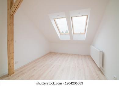 Empty bright attic room. Modern bright flat apartment in the attic.