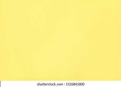 Empty bright wall of yellow. Yellow Concrete Wall Background.