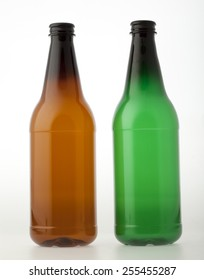 Empty brown and green plastic bottles for beer or other beverages
