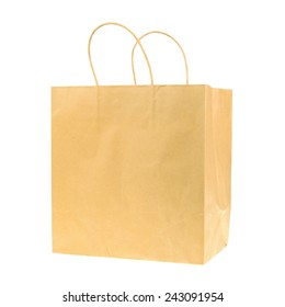 Empty brown recycled paper shopping bag isolated on white background. Side view.