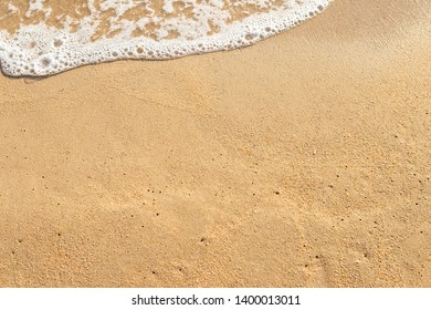 Empty brown sand beach with white wave, summer concept background, holiday and vacation background