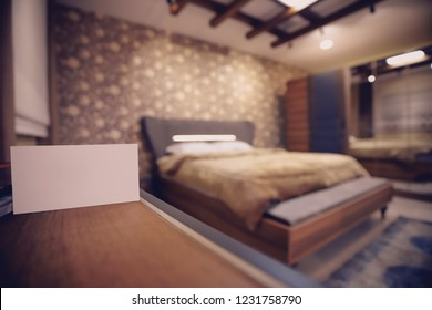 Empty brown wooden table and interior Bedrooms decoration with Mock up white business card in interior room, White Business Card Mockup label Card on a blurred interior bedroom background