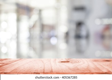 empty brown wooden table and interior blur background with bokeh image, for product display montage. Selected focus