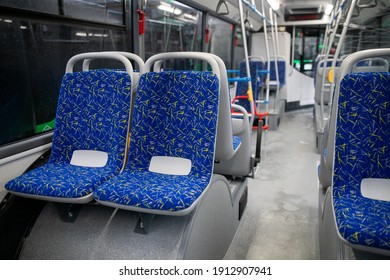 Empty bus interior. Blue seats without passengers. Public transport. Transportation of passengers by public transport. Ergonomic interior of the bus. Travel to other cities.