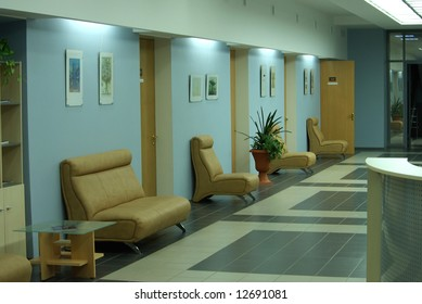 empty business interior with armchairs and doors