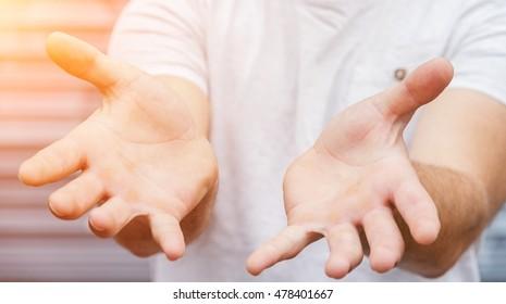 Empty businessman hand on bright blurred background