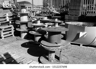 Empty cable drums and pallets outside an industrial warehouse
