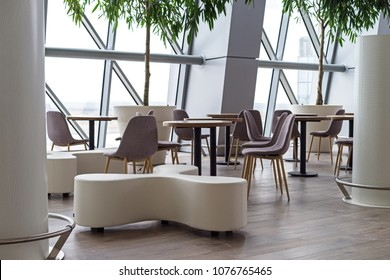 empty cafe in the airport chairs and tables, modern building