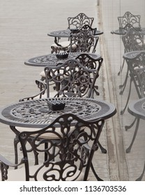 Empty cafe tables in a row