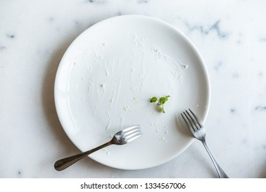 Empty cake dish with fork on table, Top view