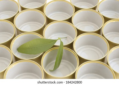 Empty cans with green leaf