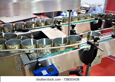 Empty cans on the conveyor of a food factory