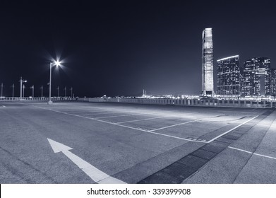 empty car park with city background