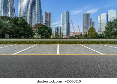 empty car park with downtown city space background