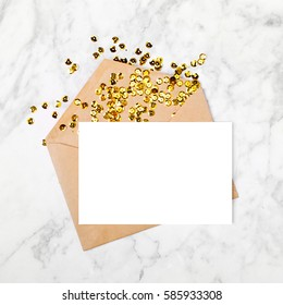 Empty card with envelope and gold confetti. Mockup template. View from above