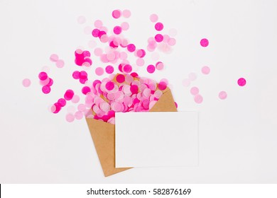 Empty card with Pink paper confetti and kraft envelope, holiday concept.