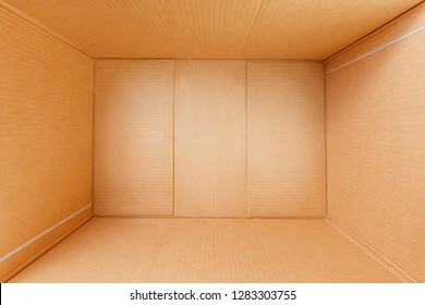 Empty cardboard box, inside view. Empty space for cargo, parcel and gift.