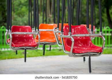 Empty Carousel flying swing ride attraction with colorful swinging chairs