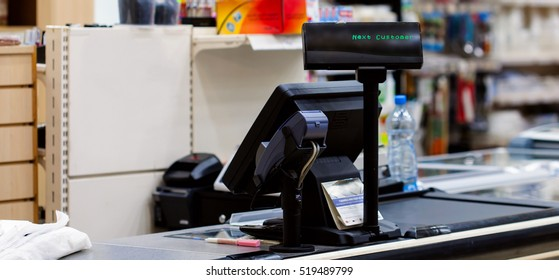 Empty cash desk with terminal in supermarket