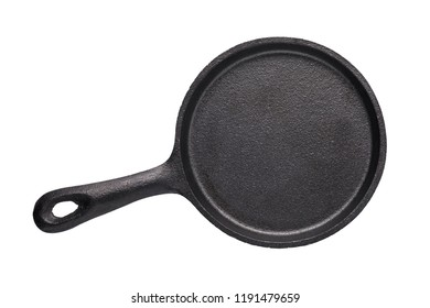 Empty cast-iron frying pan of black color isolated on white background, top view