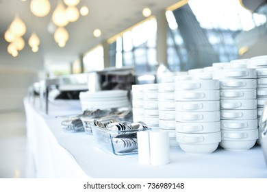 Empty catering plates, platters and trays setup before event