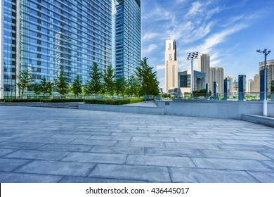 empty cement floor and modern buildings,tianjin china.