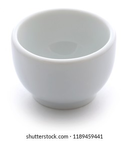 Empty ceramic bowl over white background