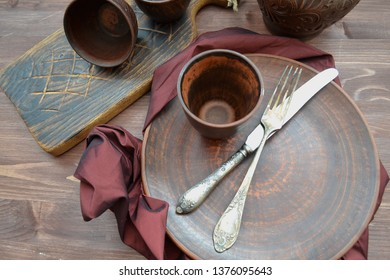 Empty ceramic dishware and wooden objets flat view
