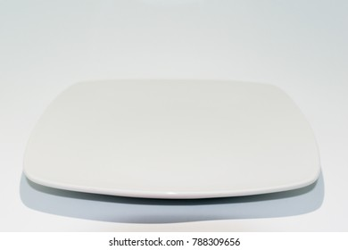 Empty ceramic plate isolated on white background. Square dish