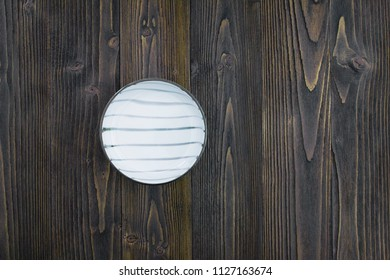 Empty ceramic plate on wooden table background.