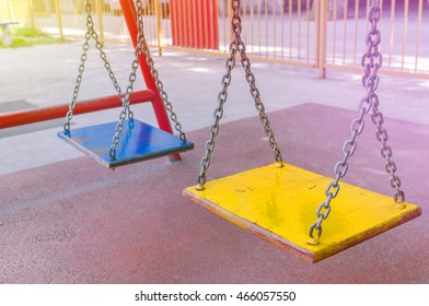 Empty chain swing in playground close