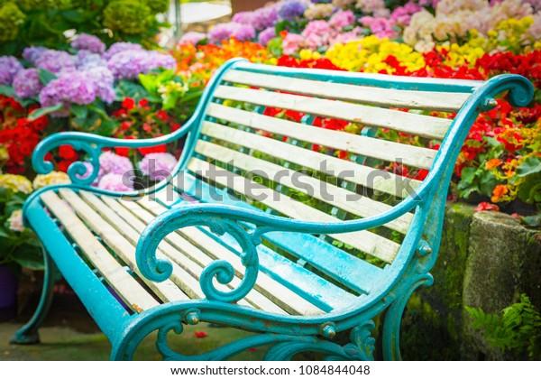 Empty chair in beautiful garden
