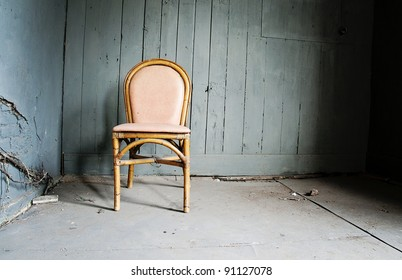 Empty chair and grungy wall