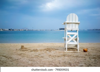 The empty chair for lifeguard on the sea.