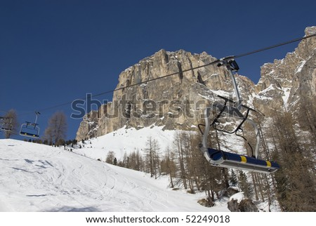 empty chair lift ski hill empty chair lift in ski resort with mountains and blue sky the background chair lift ski resort mountains stock photo edit now