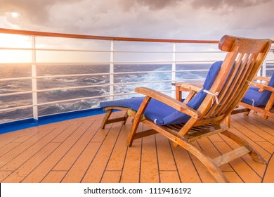 Empty chair on a ship in the sunset