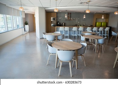 Empty chair and table in cafeteria at office
