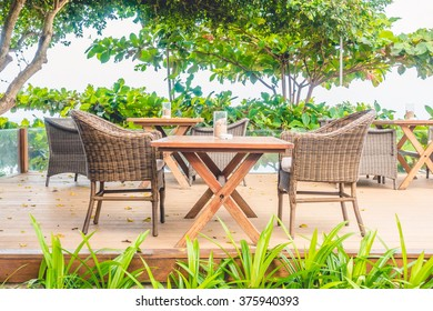 Empty chair and table with outdoor view - Light Vintage Filter