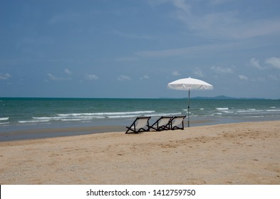 empty chair under umbrellar at the sea beach with no people
