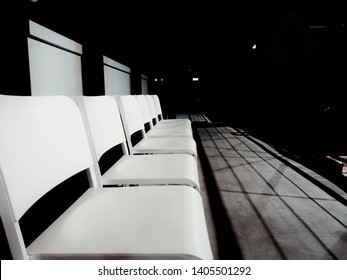 Empty chair, White empty chair with black background, Stadiums and seats.