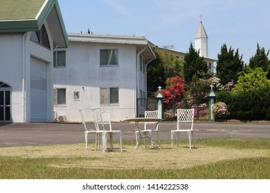 Empty chairs and Church of Trappist Monastery of Our Lady of the Annunciation in Japan. Taken in Oita, April 2018.