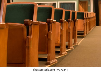 Empty chairs at cinema or theater in a row