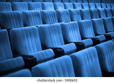 Empty chairs at cinema or theatre. Blue Tone
