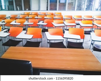 Empty chairs in classroom no student and teacher in public school with different nature over light from windows and shadow,Thailand.Soft Vintage Style.
