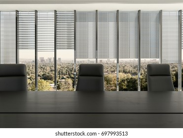Empty chairs at desk in office room against partly covered windows with cityscape in background. 3d Rendering.