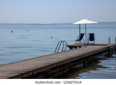 empty chairs at the garda lake