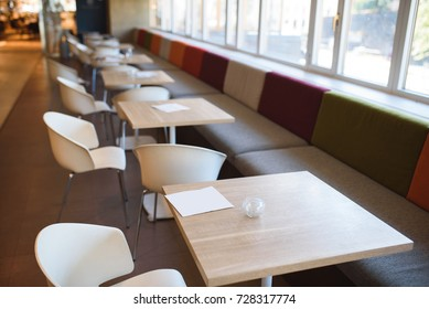 empty chairs in light nice cafe