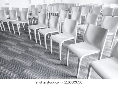 Empty chairs in the meeting room. No people.