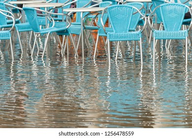 Empty chairs in Piazza San Marco in Venice during a flood.